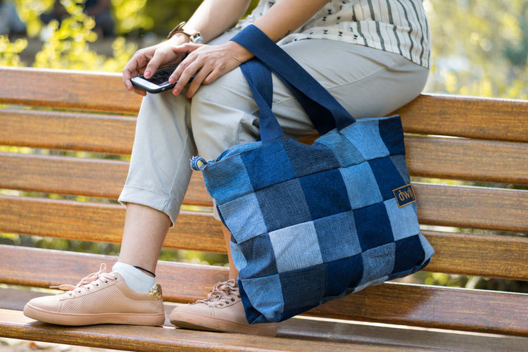 Upcycling Items Upcycling Upcycled Upcycled Bag Jeans Waiting Small Bag Bag Recycled Materials Jeans Bags Waiting Bag Bags Low Section Women Footwear Posing Shoe Canvas Shoe Human Foot Human Leg Park Bench Ground Wooden Floor Friend