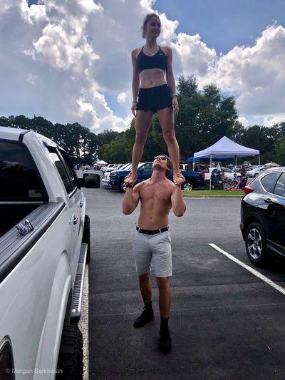 Full length of man standing on car against sky