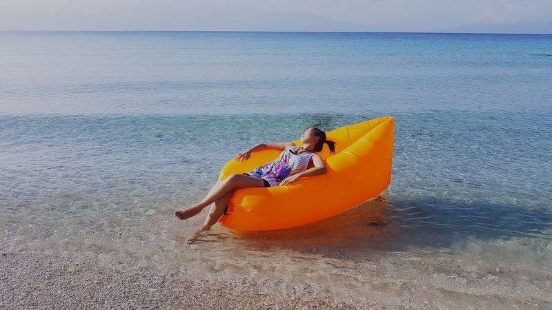 Beach Sea Water Outdoors One Person Horizon Over Water Day Nature Sitting Beauty In Nature People Only Women Relaxation Vacations Kayak Sky Sand Nautical Vessel Adult Scenics