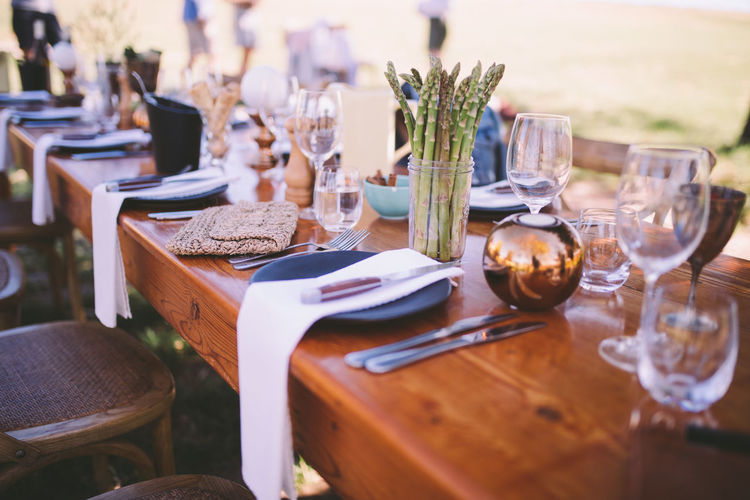 Table Glass Place Setting Household Equipment Setting No People Wineglass Drinking Glass Absence Selective Focus Food And Drink Seat Chair Furniture Plate Empty Eating Utensil Restaurant Business Indoors  Crockery