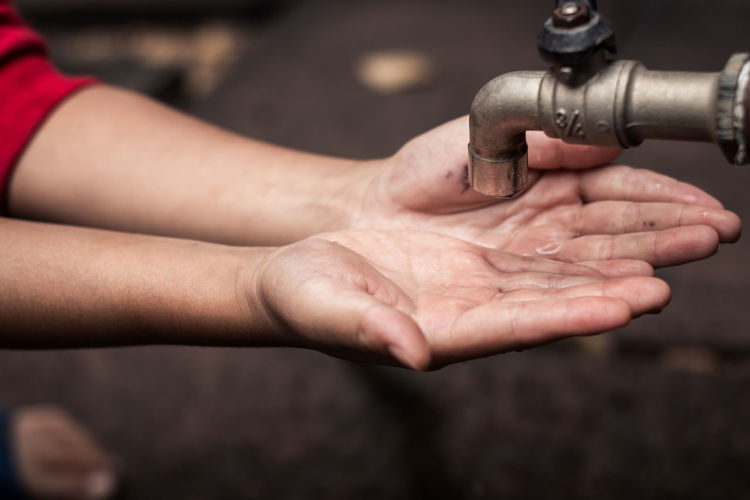 Cropped Hands Of Person Below Faucet