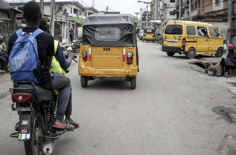 Busy streets and traffic. Lagos, Nigeria. Lagos Nigeria Busy Streets And Traffic Streetphotography EyeEm Awards 2018 People Tricycle Motorcycle Movement The Street Photographer - 2018 EyeEm Awards City Land Vehicle Street City Street Stationary City Life Traffic Road Bicycle Bus