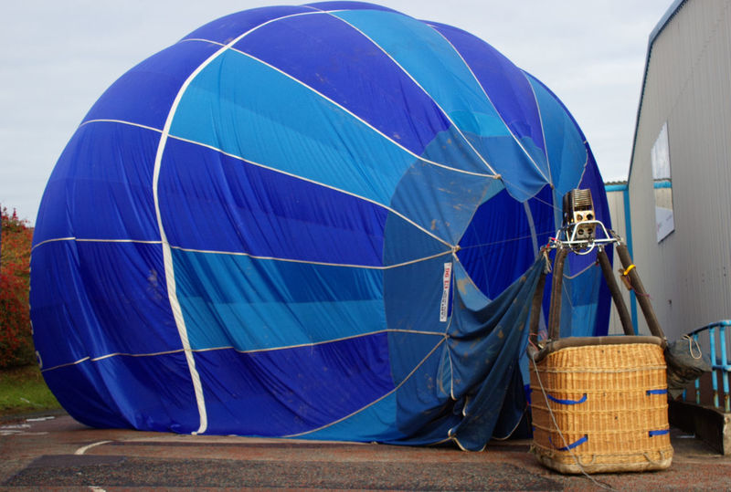 No People Outdoors Day Landed Safely Landed Industrial Park Mode Of Transport Transportation Air Vehicle Cloud - Sky Hot Air Balloon Blue