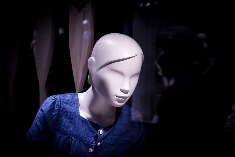 Close-up of illuminated mannequin at store