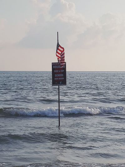 Politics And Government Water Sea Beach Sunset Clear Sky Patriotism Red Sand Urban Skyline
