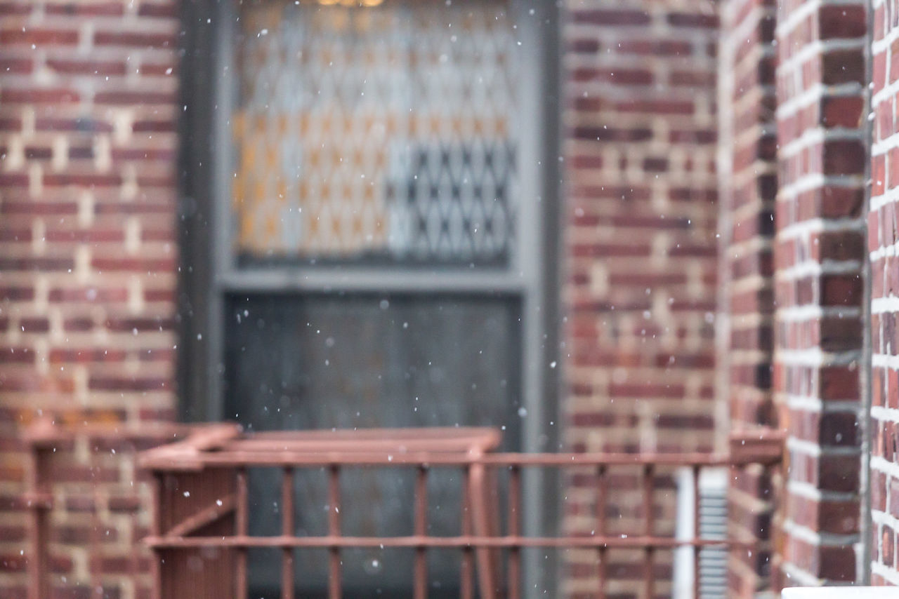 architecture, built structure, brick wall, brick, building exterior, window, wall, glass - material, no people, building, city, day, transparent, outdoors, wet, raindrop, rain, reflection, wall - building feature, snowing, rainy season