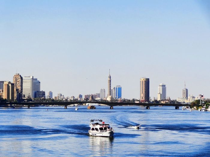 Water Architecture Building Exterior City Urban Skyline Built Structure Nautical Vessel Sea Travel Destinations Skyscraper Outdoors Clear Sky Sky Nature Beach Day No People Cityscape The Nile River