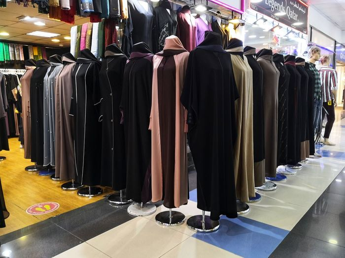 Row of clothes hanging at store