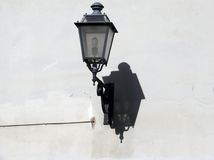 Lamp Post Mounted On White Wall