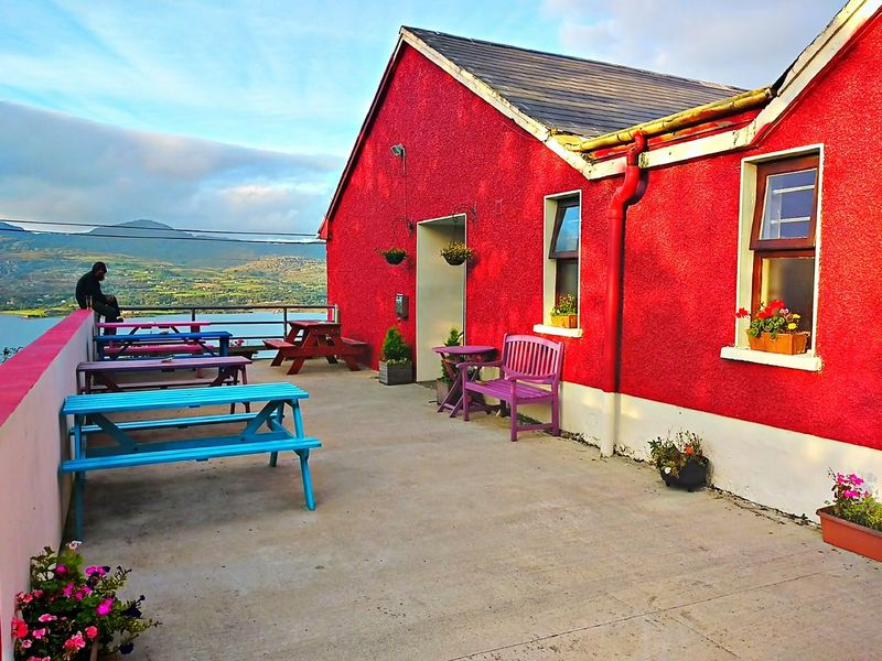 Red Architecture Built Structure Building Exterior Outdoors Day Sky Irish Pub Ireland Beara Island Bere Island Table Multi Colored Scenics Beauty Pub Benches Plants Flowers Mountain Windows Blue Table Red House