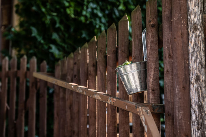 Gardening Barrier Boundary Close-up Day Fence Focus On Foreground Gate In A Row Metal Nature No People Outdoors Protection Safety Security Selective Focus Sharp Sunlight Wood - Material