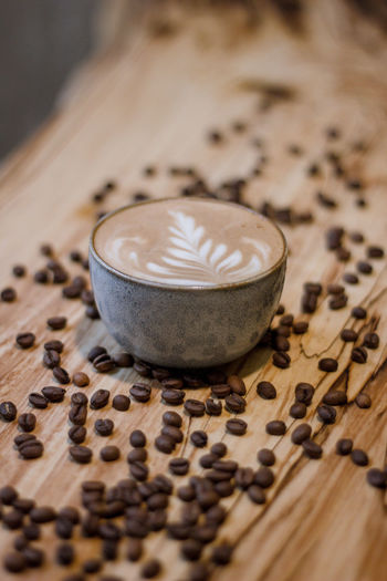Coffee Coffee - Drink Coffee Cup Coffee Time Coffee Break Food And Drink Indoors  No People Selective Focus Drink Cup Still Life Close-up Wood - Material Cappuccino Mug Refreshment Hot Drink Pattern Food Freshness Focus On Foreground Latte Place Mat Crockery