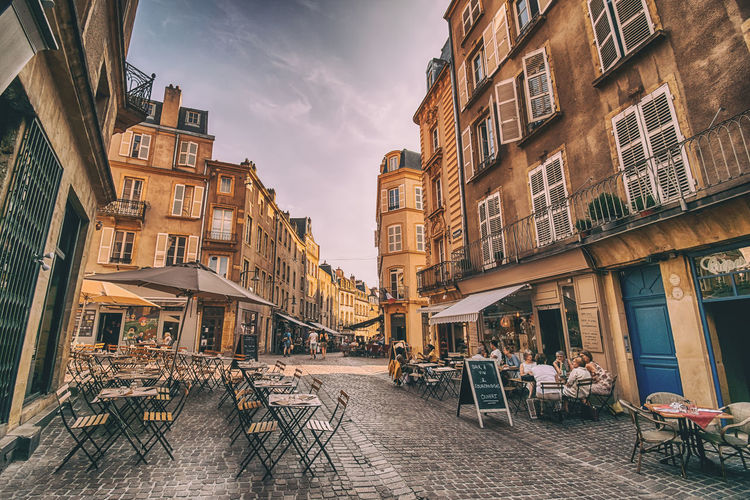 Let's chair some memories. Atmospheric Mood Atmosphere Tables And Chairs Tables Building Exterior Built Structure The Architect - 2018 EyeEm Awards Vive La France City City Street Town TOWNSCAPE France Europe Metz, France Cityscape City Life Street Photography The Street Photographer - 2018 EyeEm Awards Restaurant Togetherness Sunset Streetphotography Architecture_collection Architecture