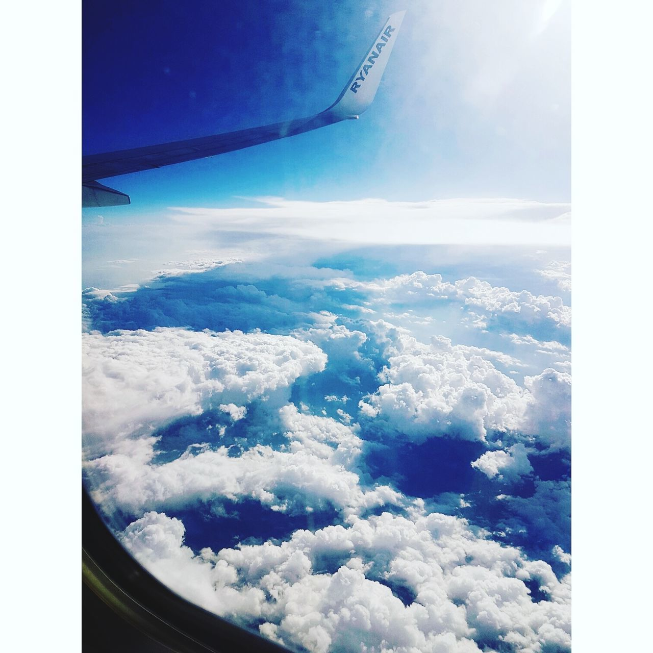 airplane, transportation, cloud - sky, sky, aerial view, scenics, mode of transport, air vehicle, flying, nature, beauty in nature, travel, journey, cloudscape, tranquil scene, airplane wing, blue, tranquility, no people, day, outdoors, mid-air, aircraft wing, landscape, vehicle part
