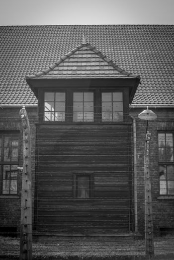 Auschwitz Auschwitz  Built Structure Architecture Building Exterior Building No People Day Roof Sky House Entrance Residential District Door Outdoors Window Wood - Material Nature Closed Protection Old History