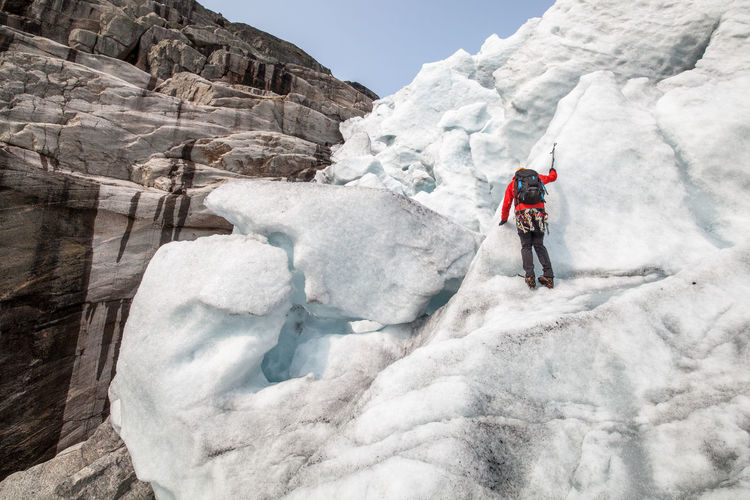 Rear view of person ice climbing