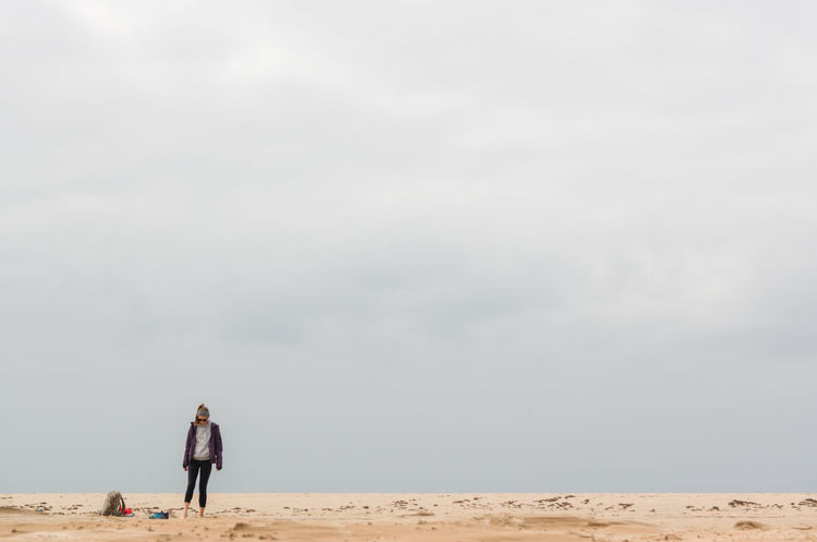 Alone Beach Cloud - Sky Day Girl Grey Sky Nature One Person Outdoors Sand Sky Winter Winter Beach Young Adult