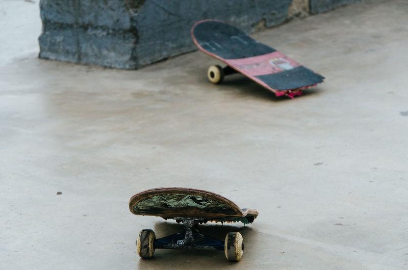 Broken skateboard at playground