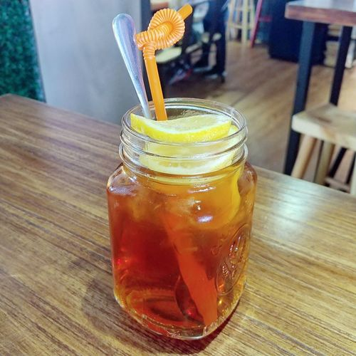 Lemon Tea in Hong Kong Style. Hong Kong Drink ASIA Lemon Tea Drink Drinking Glass Ice Cube Cold Temperature Drinking Straw Table Ice Tea Cola Tonic Water Ice Citrus Fruit Mint Leaf - Culinary Mint Tea Lemon