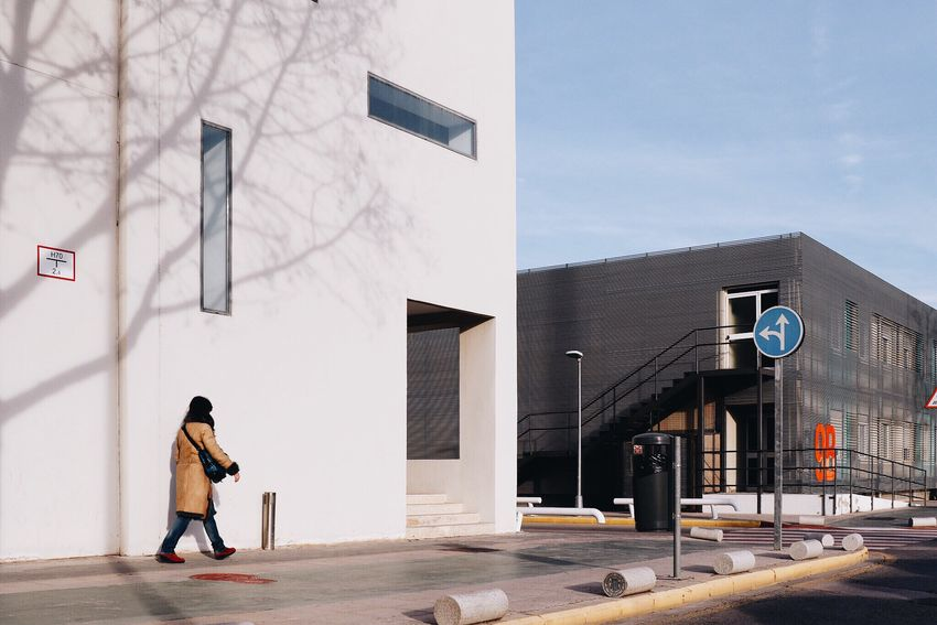 Woman Girl Walking Shadow Figure Lonely Scene Everyday Lives Every Picture Tells A Story Architecture Wall Sign Traffic Sign Building Perspectives Urban Lifestyle Solitary Outdoors Streetphotography Young Adult Entrance Urban Windows Sidewalk White