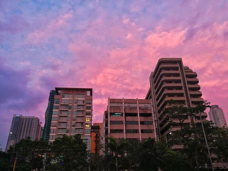 City Skyscraper Urban Skyline Cityscape Outdoors Architecture Sunset Cloud - Sky Low Angle View Millennial Pink City Illuminated Lights Cityscape City Street Travel Destinations EyeEmNewHere First Eyeem Photo EyeEmBestPics EyeEm Best Shots Eyeem Philippines Photooftheday Adults Only Sky Modern