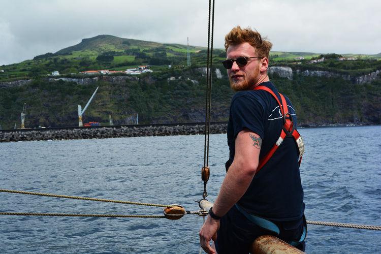 Portrait Of Man Standing In Boat