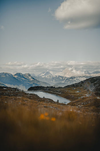 Beauty In Nature Cloud - Sky Cold Temperature Environment Lake Landscape Mountain Mountain Range Nature No People Non-urban Scene Outdoors Scenics - Nature Sky Snow Snowcapped Mountain Tranquil Scene Tranquility Water Winter