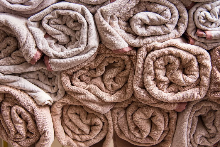 Beach bath towel rolls blue fabric texture cloth background used for swimming pool Abundance Arrangement Backgrounds Choice Close-up Collection Complexity Day Full Frame Indoors  Large Group Of Objects No People Order Pattern Repetition Rope Softness Stack Still Life Textile Towel Variation