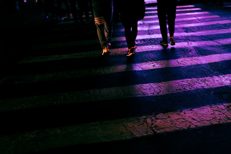 Walking Low Section Human Leg Body Part Group Of People Night Human Body Part Adult City Lifestyles People Real People Women Shadow Street Men Illuminated Architecture Human Limb Limb