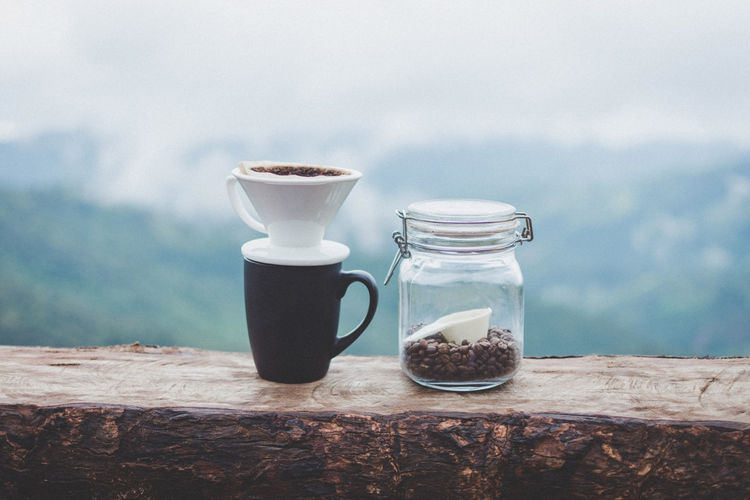 Close-up Coffe Coffee Coffee - Drink Container Cup Day Drink Drip Coffee Focus On Foreground Food Food And Drink Freshness Glass - Material Indoors  Jar Nature No People Still Life Table Transparent Wood - Material
