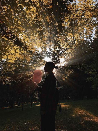 Woman holding cotton candy in park