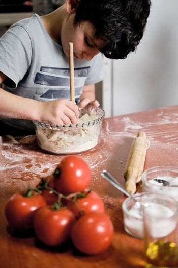 Midsection of man preparing food on cutting board