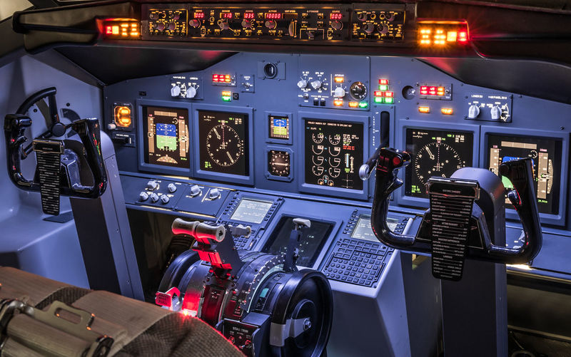 High angle view of illuminated control in airplane cockpit