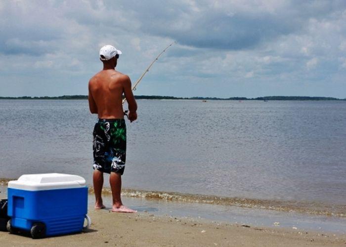 Bay Beach Blue Cloudy Cooler Day Fishing Fishing Pole Hoping  No Shoes Rear View Searching Shirtless Standing Swim Trunks Tan Skin Waiting Water White Hat