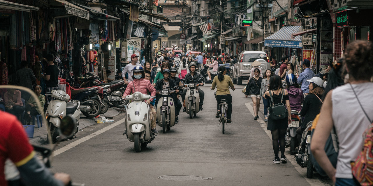 bicycle, transportation, mode of transport, large group of people, land vehicle, real people, men, city, motorcycle, day, outdoors, people, adult