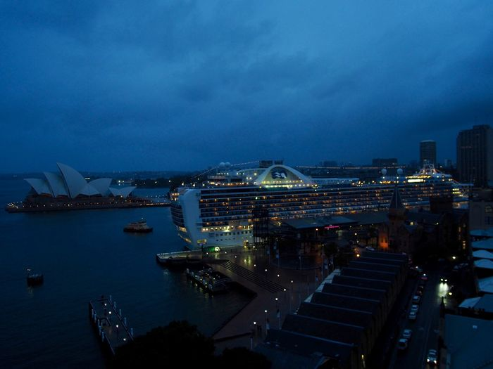 Australia Built Structure Business Finance And Industry City Cityscape Cruise Ship Dawn Downtown District Harbor Illuminated Nautical Vessel Night No People Opera House Outdoors Sea Sky Skyscraper Sydney Transportation Travel Destinations Urban Skyline Water
