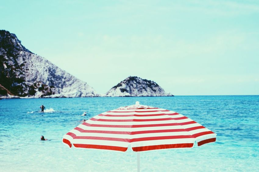 Greece Beautiful The Still Life Photographer - 2018 EyeEm Awards EyeEmNewHere The Great Outdoors - 2018 EyeEm Awards Water Sea Sky Land Beauty In Nature Horizon Over Water Horizon Scenics - Nature Beach Nature Day Incidental People Vacations Tranquility Holiday Trip Tranquil Scene Clear Sky Umbrella Outdoors The Still Life Photographer - 2018 EyeEm Awards