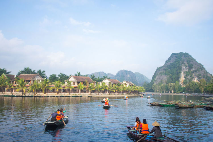 Tam Coc, Vietnam Water Nautical Vessel Mountain Transportation Mode Of Transportation Sky Real People Day Nature Beauty In Nature Group Of People Men Waterfront Lifestyles Tree River Cloud - Sky Plant Kayak Outdoors Mountain Range Tam Coc Vietnam Travel