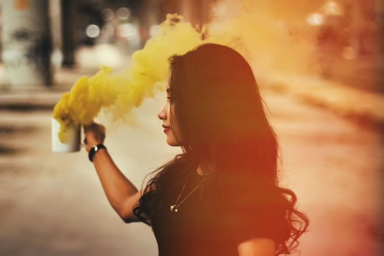 Adult Beautiful Woman Casual Clothing Focus On Foreground Hair Hairstyle Happiness Headshot Holding Leisure Activity Lifestyles Long Hair One Person Portrait Profile View Real People Side View Smoke - Physical Structure Women Yellow Young Adult The Troublemakers The Portraitist - 2018 EyeEm Awards