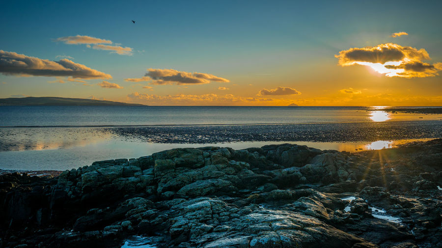 Cloud Orange Reflection Troon Beauty In Nature Blue Foreground Nature Rocks Sea Sun Sunset Tranquil Scene Tranquility Water