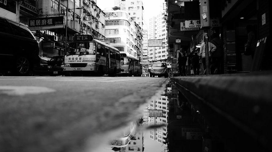Street reflection B/W HongKong Discoverhongkong Leica Leicaq Streetphotography Water Reflections Blackandwhite Streetphoto_bw EyeEm Best Edits EyeEm Best Shots EyeEm Gallery EyeEmBestPics Eye4photography  EyeEm Best Shots - Black + White Hello World The Architect - 2016 EyeEm Awards