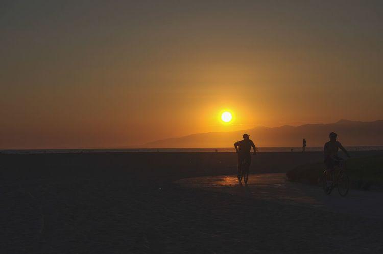 Venice Beach, bicycling. EyeEmNewHere Venice Beach Los Angeles, California Sunset Sun Nature Beach Silhouette Sea Beauty In Nature Sky Sunlight EyeEmNewHere
