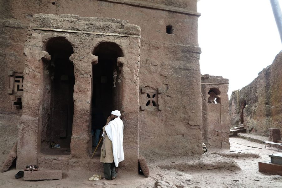Ancient Ancient Civilization Ancient History Architectural Column Architecture Building Exterior Built Structure Church Day EthiopianOrthodox History Men Outdoors People Real People The Past Travel Destinations