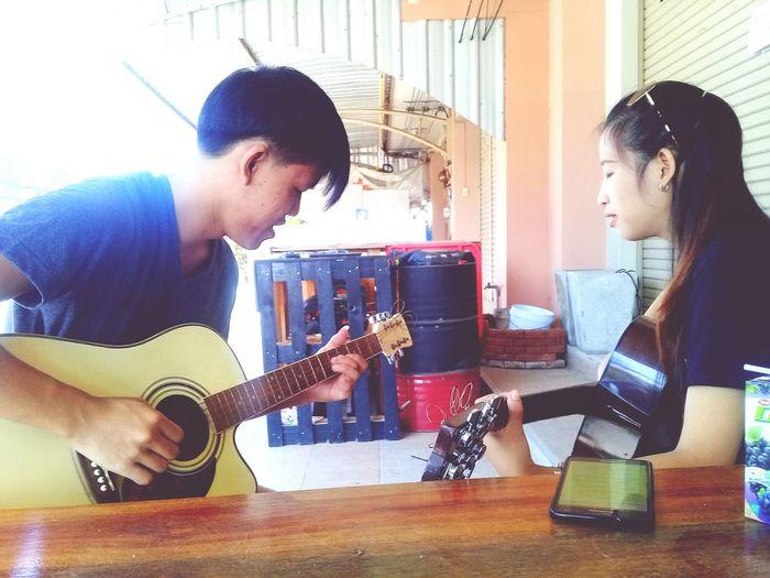 Brothers play music Guitar Women Man Playingtheguitar Plucking An Instrument Musician Guitar Musical Instrument Men Friendship Working Music Playing Electric Guitar