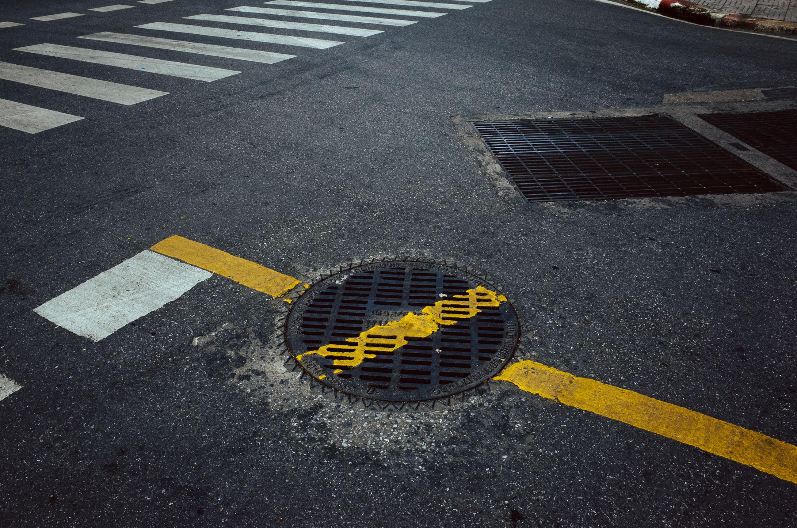 asphalt, transportation, road, metal grate, outdoors, day, no people