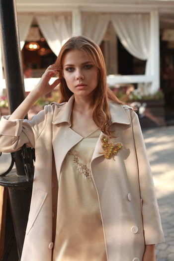 Adult Beautiful Woman Beauty Clothing Contemplation Fashion Front View Hair Hairstyle Leisure Activity Lifestyles Long Hair Looking At Camera One Person Portrait Real People Standing Women Young Adult Young Women