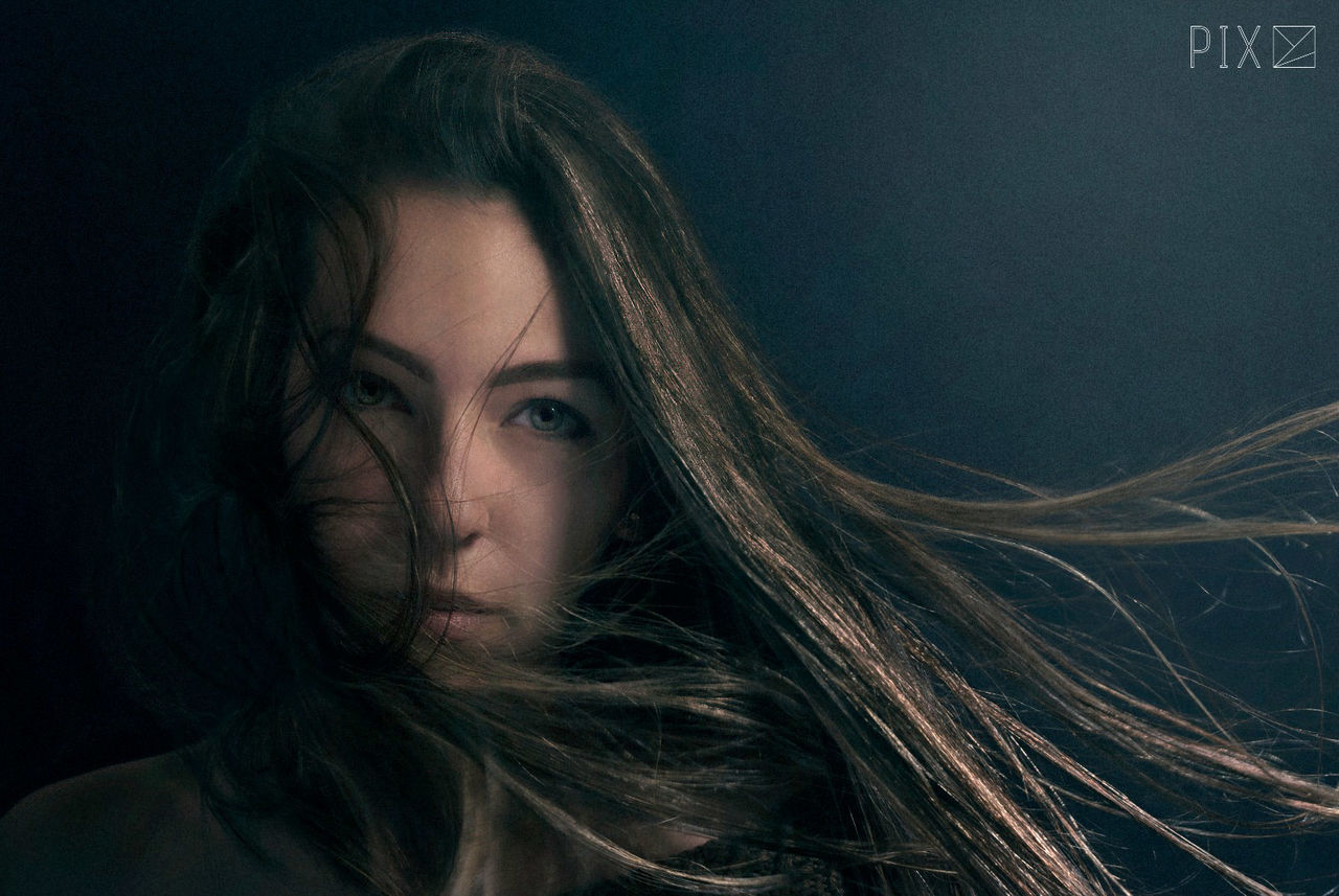 beautiful woman, looking at camera, long hair, young adult, night, headshot, one person, young women, portrait, real people, close-up, black background, indoors, people