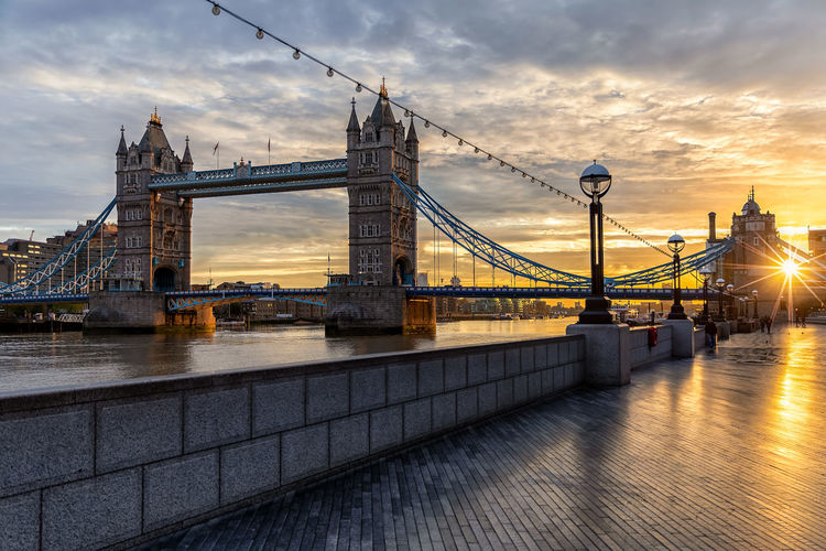 Tower bridge over thames river during sunset in city