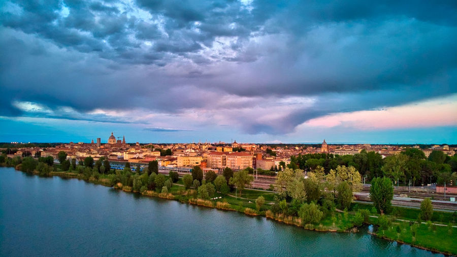 Italy, Mantua: aerial view of the city Drone  Drone Photography Aerial View From A Distance Scenics Outdoors No People No One Nobody Day Daylight Daytime Horizontal Sunset Dusk Horizon Over Land Cloud - Sky Windy Serene Reflection Lake Skyline Mantua Mantova Renaissance Vegetation Limit Bank Architecture Building Exterior Sky Built Structure Water Building City Nature River Residential District Cityscape Travel Destinations House Scenics - Nature Plant