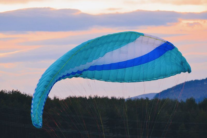 With the summer wind Paragliding Sky Nature Cloud - Sky Multi Colored Blue Mid-air Summer Sports Flying Sunset Creativity Outdoors Beauty In Nature Motion #urbanana: The Urban Playground